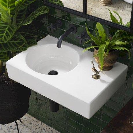 CLARK round wall basin with right hand shelf.jpg